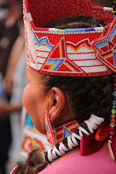 I hope you can see the intricate bead work on this headdress. Although the women's headdresses are not as loud and bold as the men, more than likely as ,we as a gender are not either, they are so beautiful. Created with thought and patience, just like us!