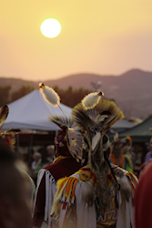 Look at this shot... sun setting in the 108 temp sky, the men are awaiting to be called to dance, I am sweating with a bunch of strangers wishing they would all just disappear so I could take my pictures without them standing in front of me like I don't have a camera shoved in my face.