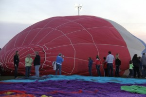 The balloons are being filled and getting ready to be raised.
