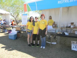 We are given our yellow shirts as to identify us as volunteers and we are off to setting up the food tent.